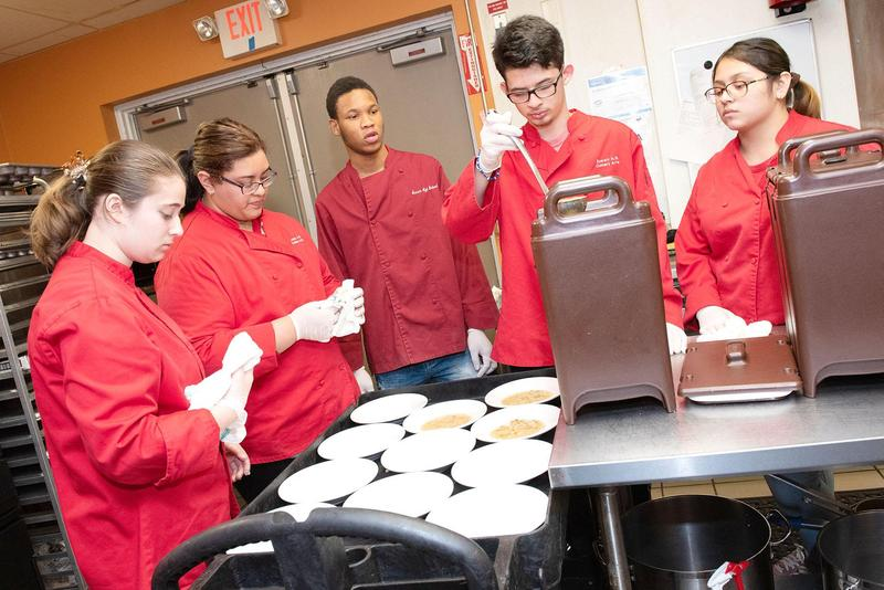 Culinary Arts students prepare lunches inside the EHS kitchen