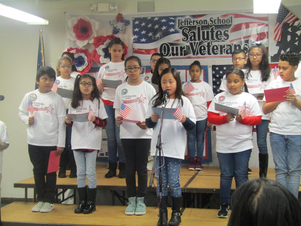 girl reading veterans poem at assembly