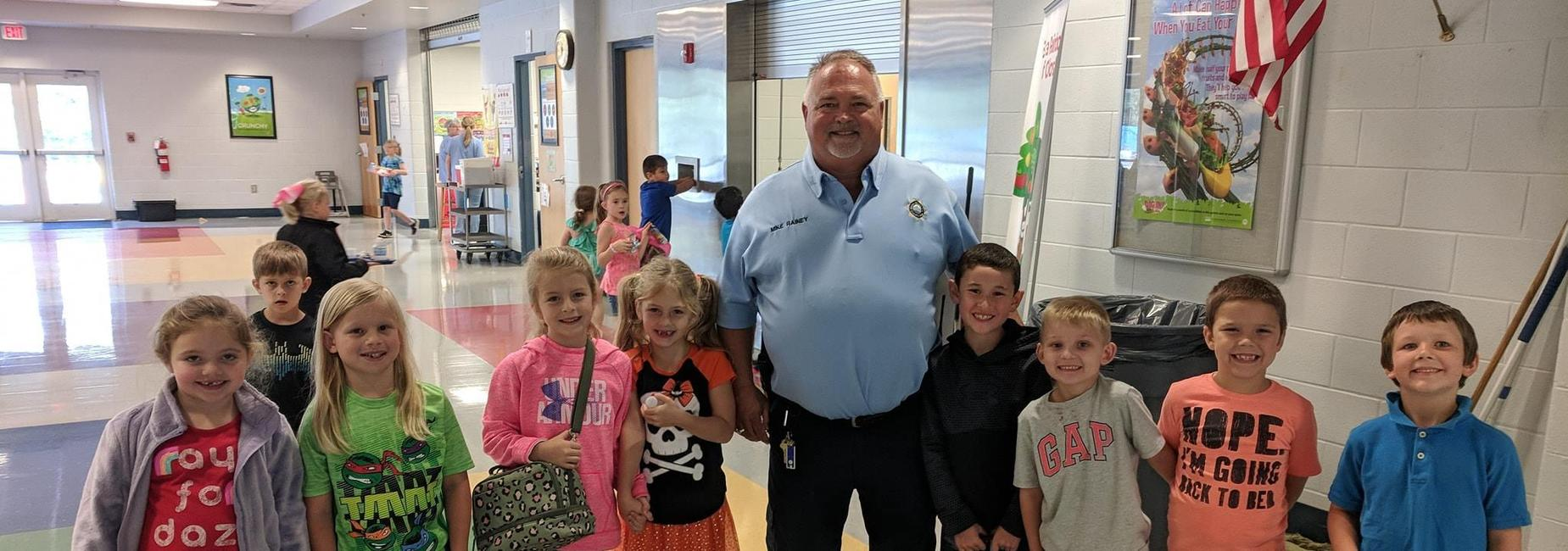 Officer Rainey and Elementary Students