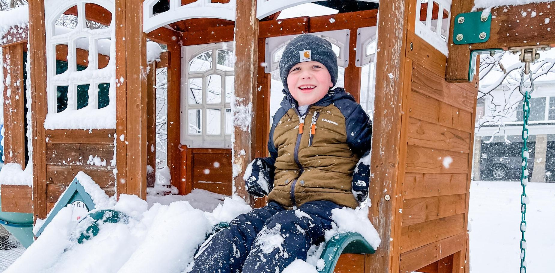 picture of child playing in snow