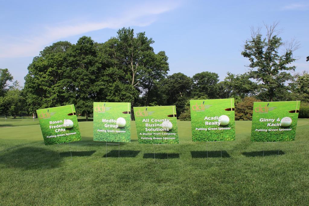 DDI Golf Outing sponsor signs
