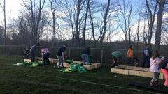 Many families helped prepare our raised garden beds.