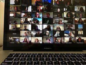 large staff shot of zoom meeting