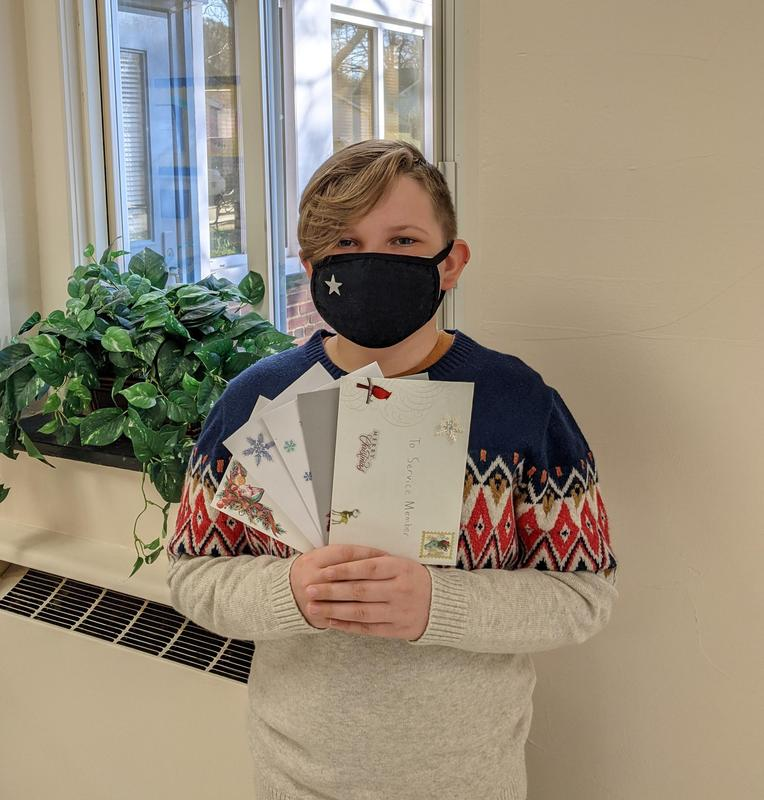 Student holding cards