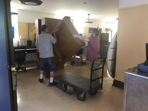 photo of staff moving items into cafeteria