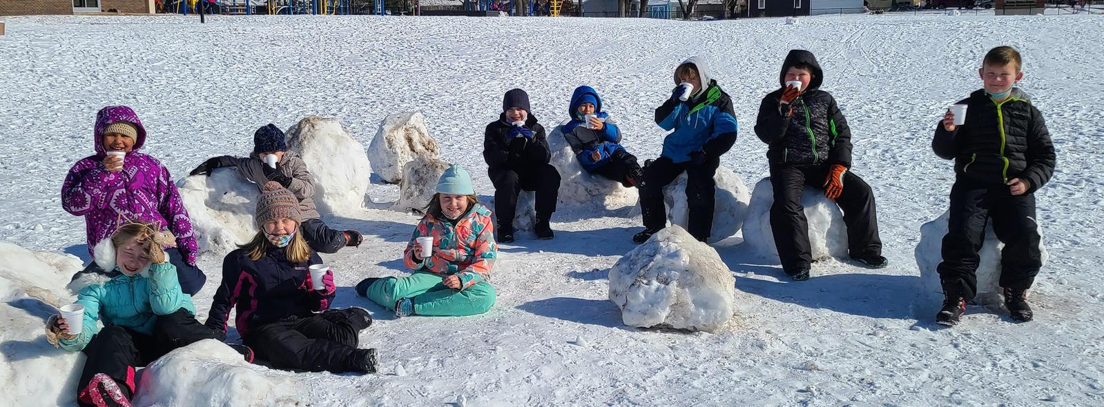 Kids outside at recess in the snow