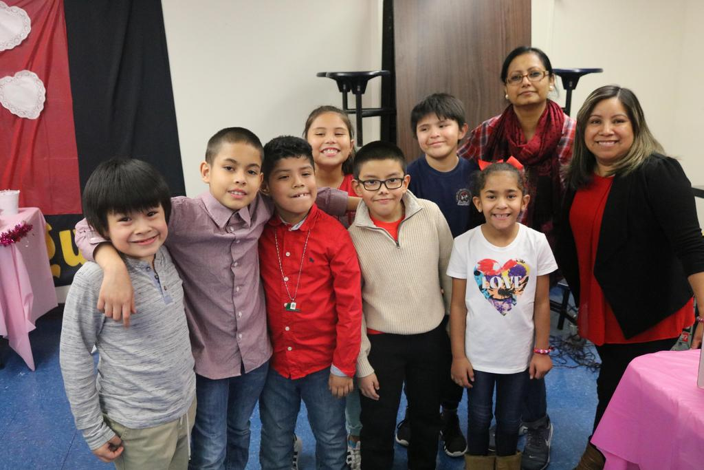 group of boys and happily standing with two moms