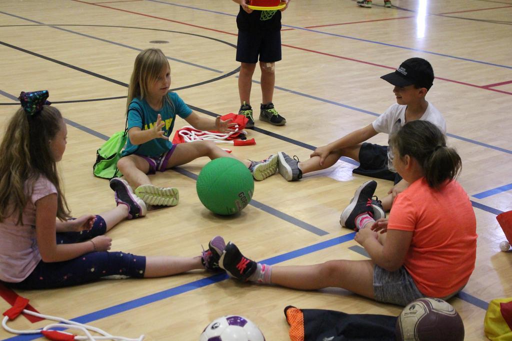L-R-A circle of campers at Camp Good Sam—Marianna Williams, Hadleigh Gahan, Kaleo Grafia and London Reese.