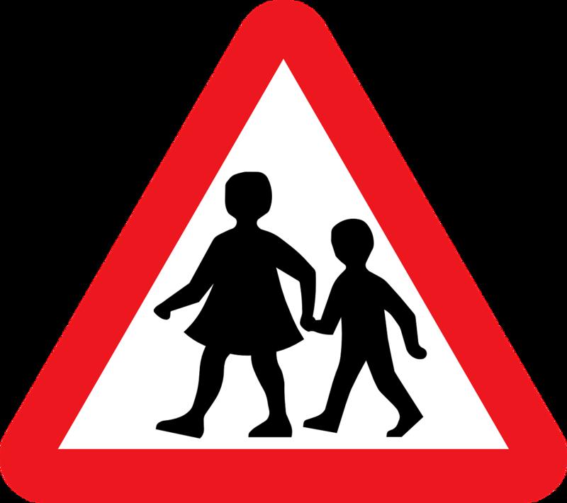 School kids crossing street sign