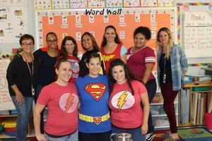 12 teachers showing off their superhero t's