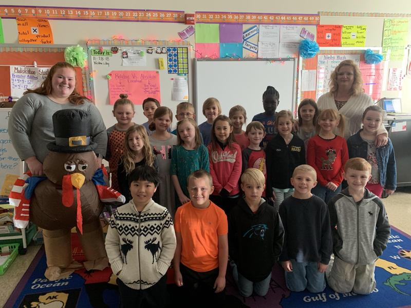 Ms Martin's class celebrates reading 2352 books.