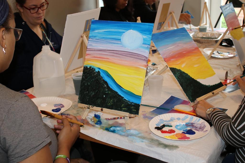 Staff enjoying DSP Week (painting)