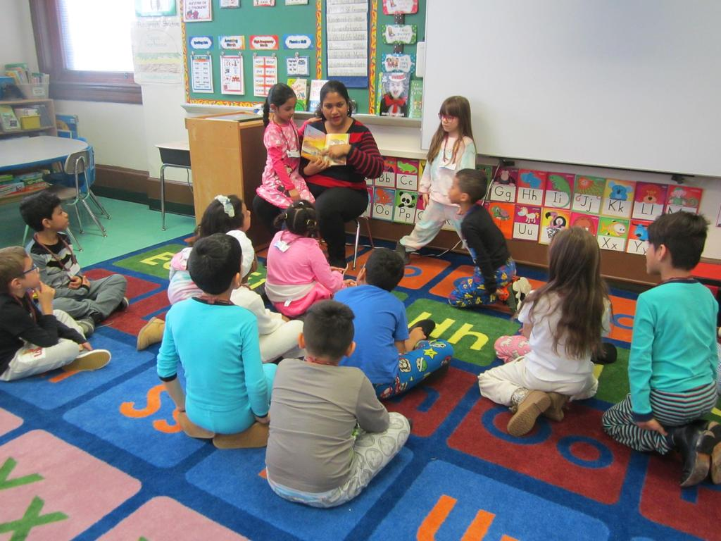 mom with daughter on lap reading to the class