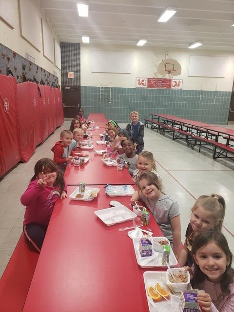 Children enjoying breakfast at Elms Road Elementary as part of the Before and After School Care Program.