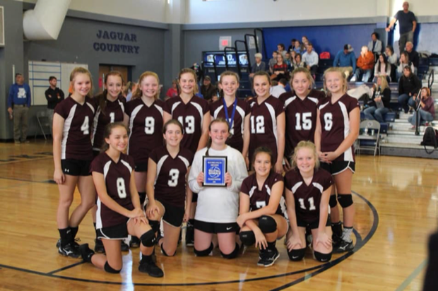 EWMS Girls Volleyball Team poses with award.