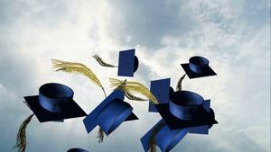 Graduation Hats Flying