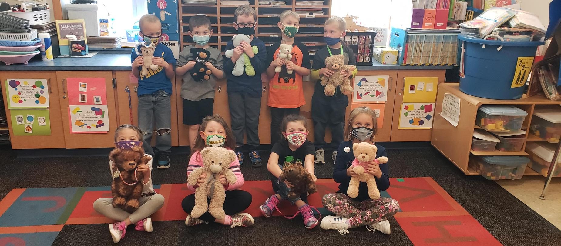students with teddy bears