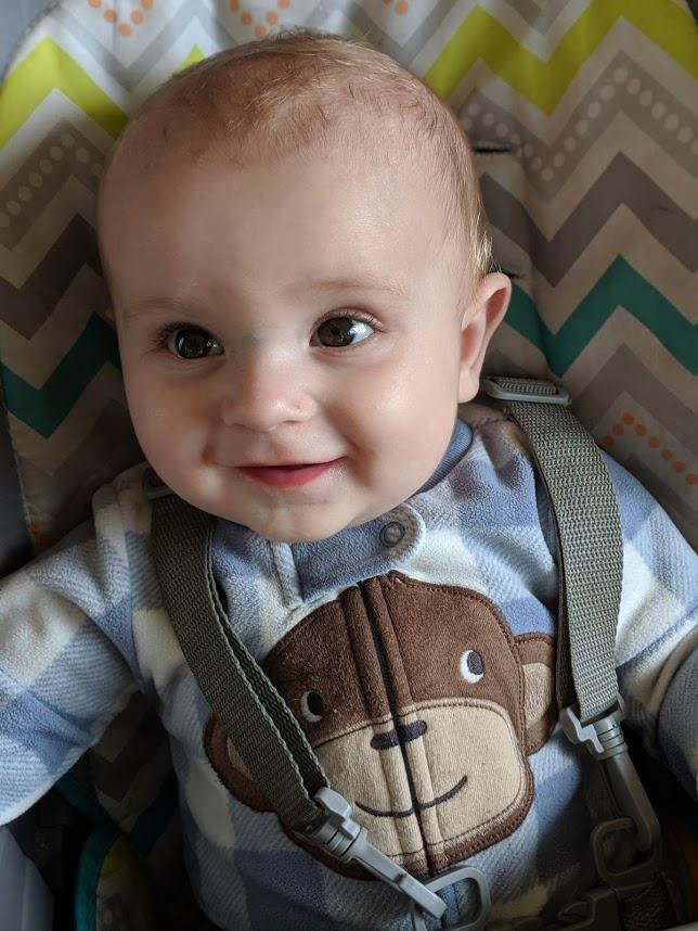 Baby boy smiling.