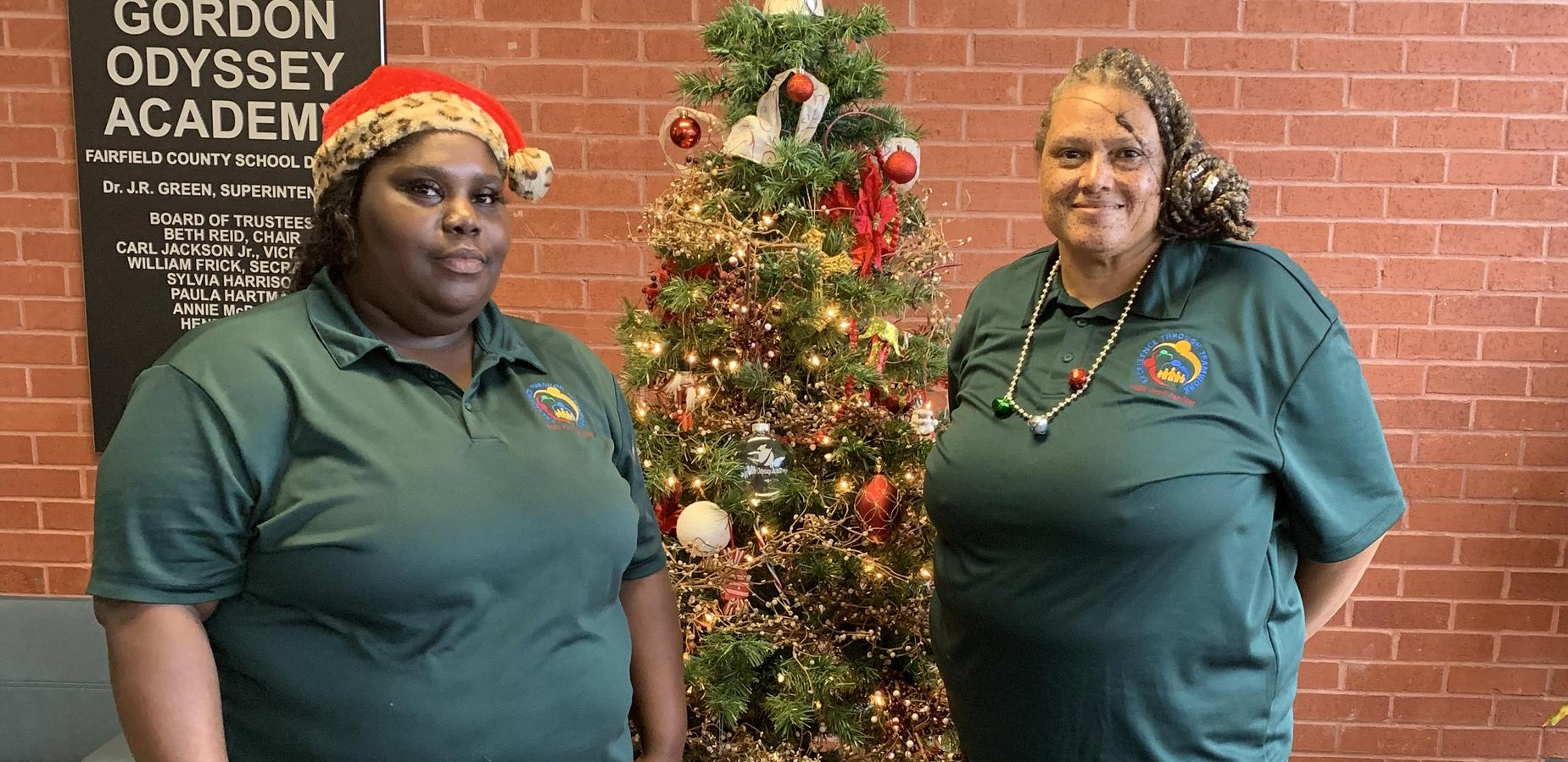 Food Service Staff posing in front of the Christmas tree