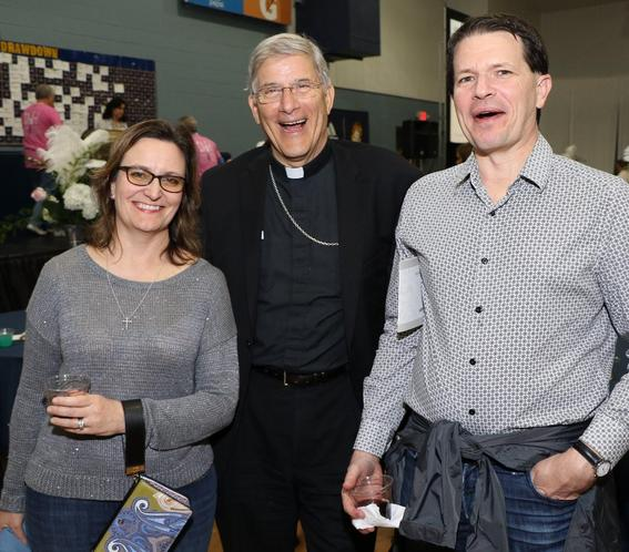 2 men and 1 woman smiling