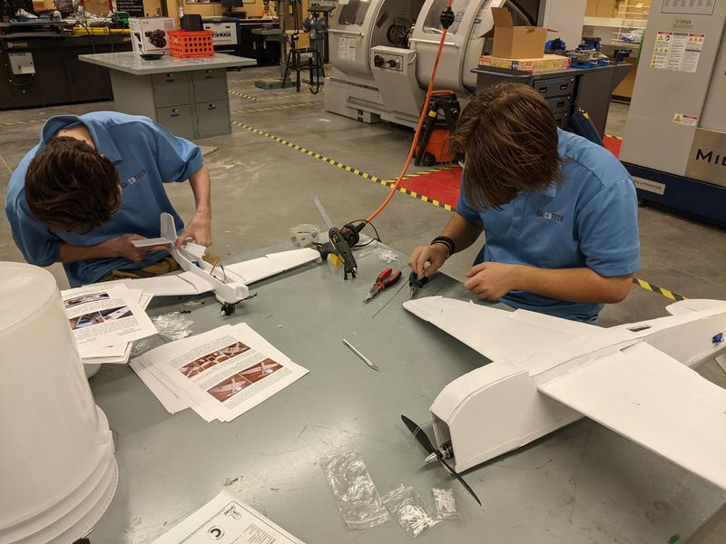 Flight tech students building remote controlled airplanes