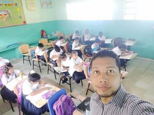 Teacher Isaac Murillo and his students.jpg