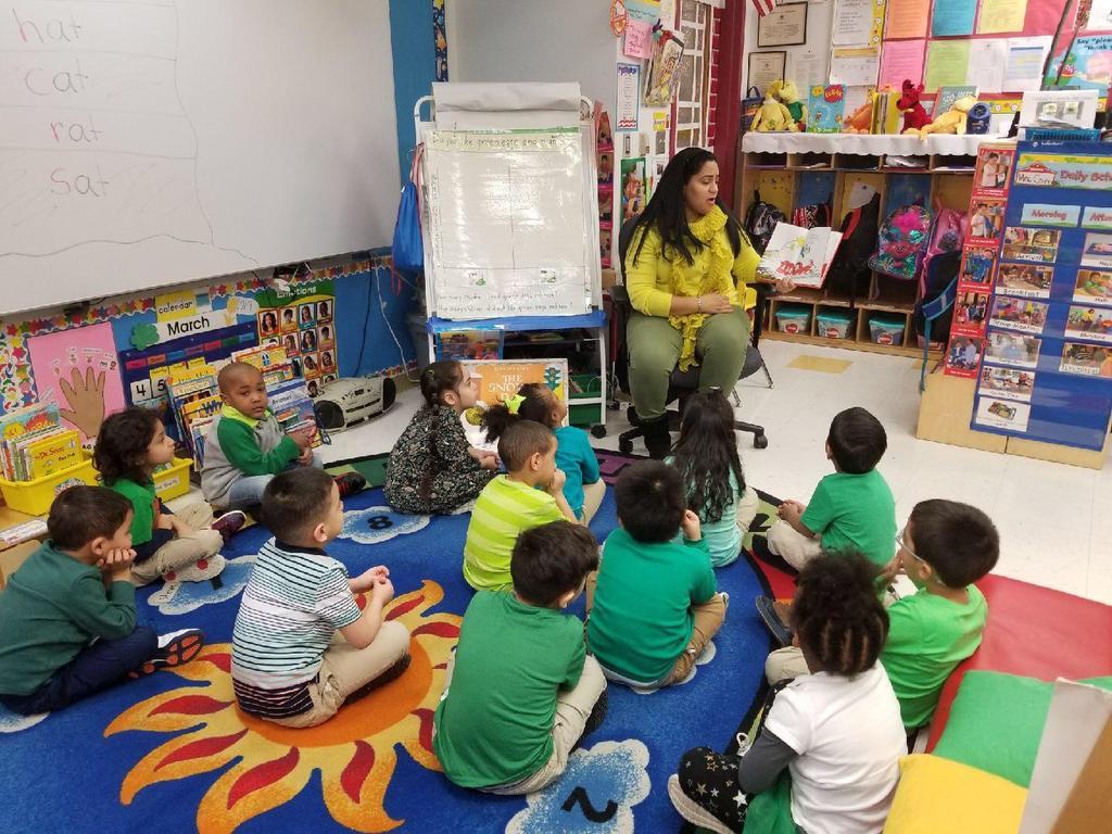 teacher's aide reading green eggs & ham