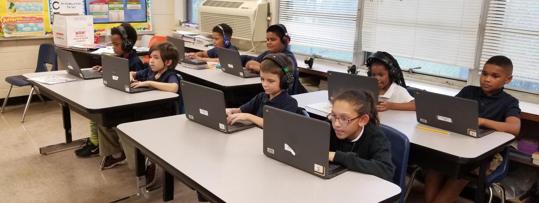 Mrs. Davis' Second Graders Enjoying Their New Classroom Tables