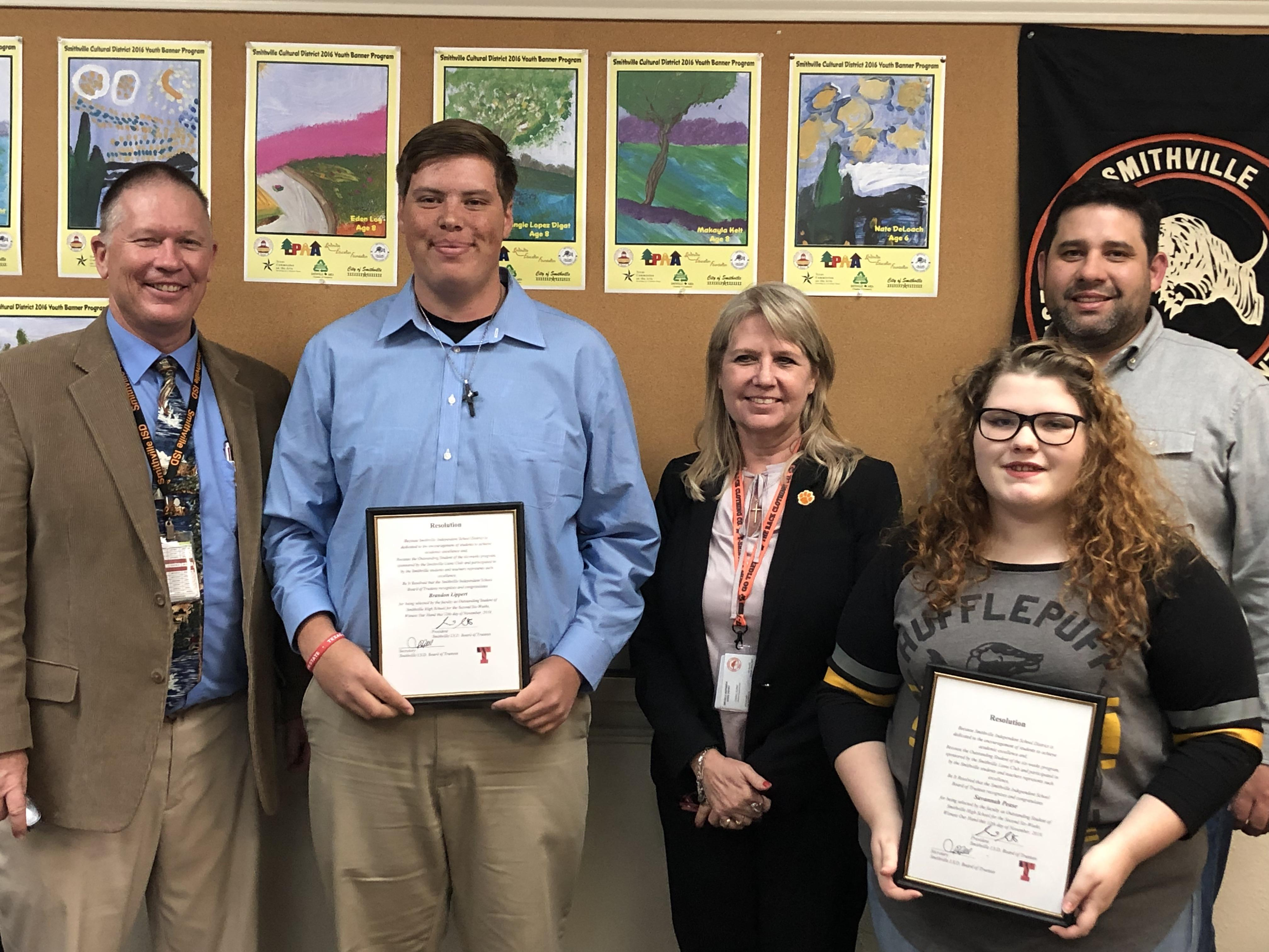 high school students receive outstanding student recognition