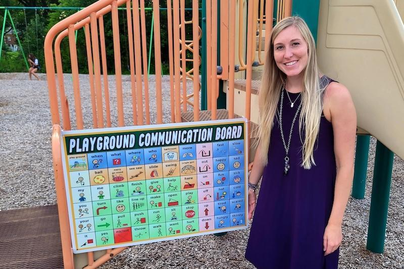 Ms. Laughner with a communication board