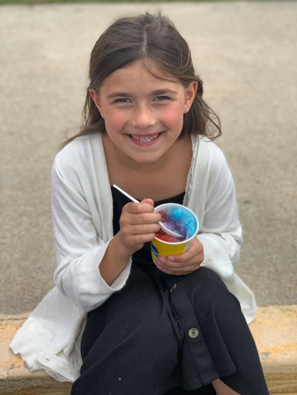 Girl eating a snowcone