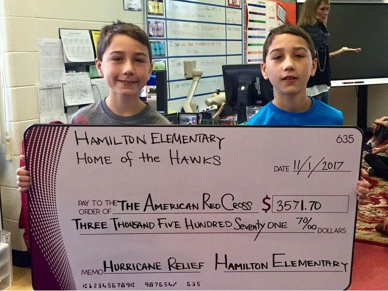 boys holding check for American Red Cross