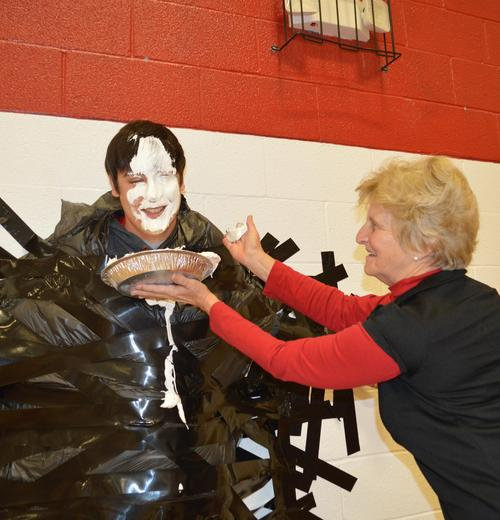 Coach JoJo gets a pie in the face by Mrs. Candy.