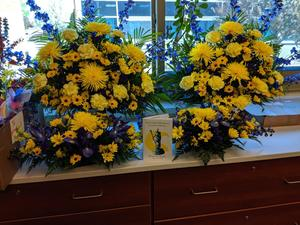 flowers behind desk in main office