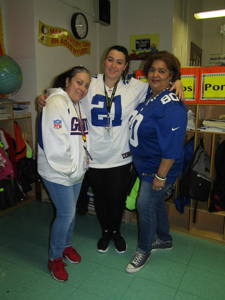 three women wearing giants jerseys