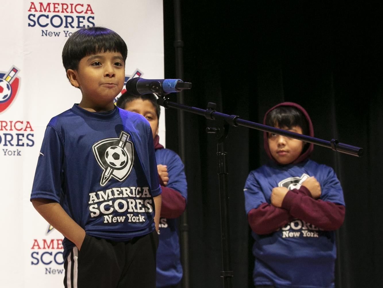 Boy participates in America Scores Poetry Slams
