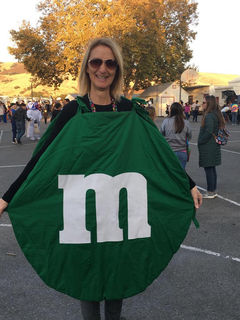 teacher dressed up as green m&m