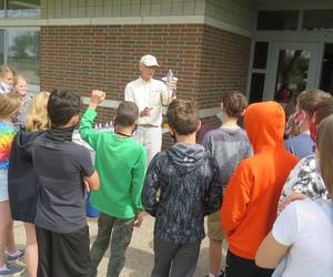 Bruce Medaugh, director of Starbase in Battle  Creek, explains to students how the rockets work.