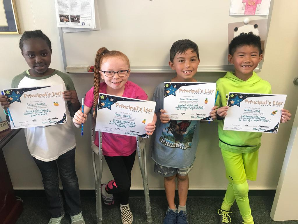 Four students receiving a Principal's award