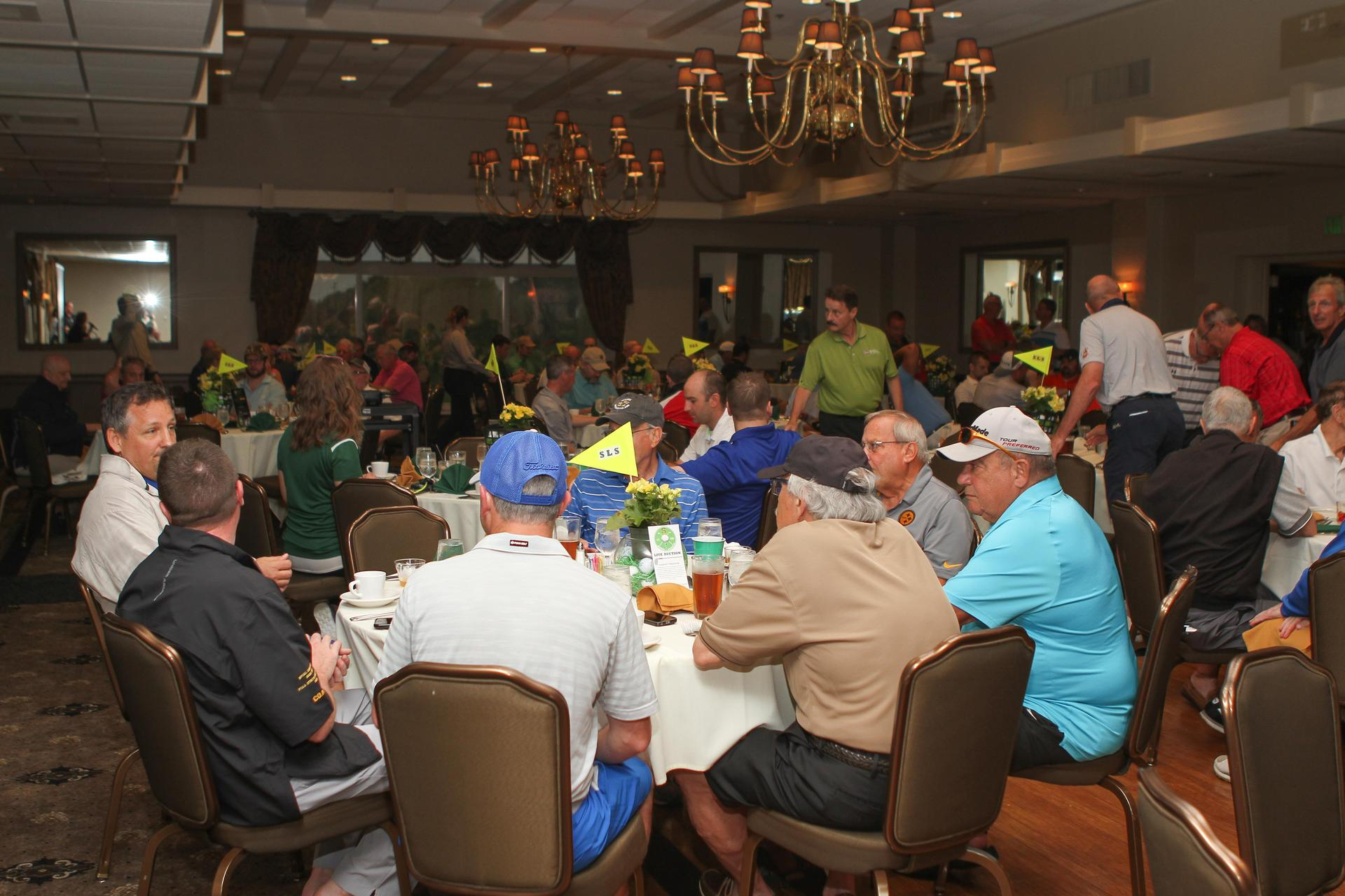 golfers sit down for lunch at the Rebel Classic Golf Outing