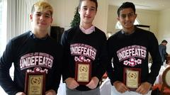 picture of 3 students with soccer awards