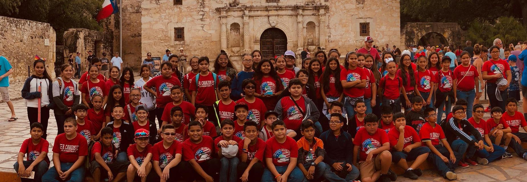 5th grade pic in front of the Alamo