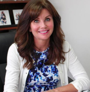 Picture of Superintendent wearing blue flowered top and white sweater