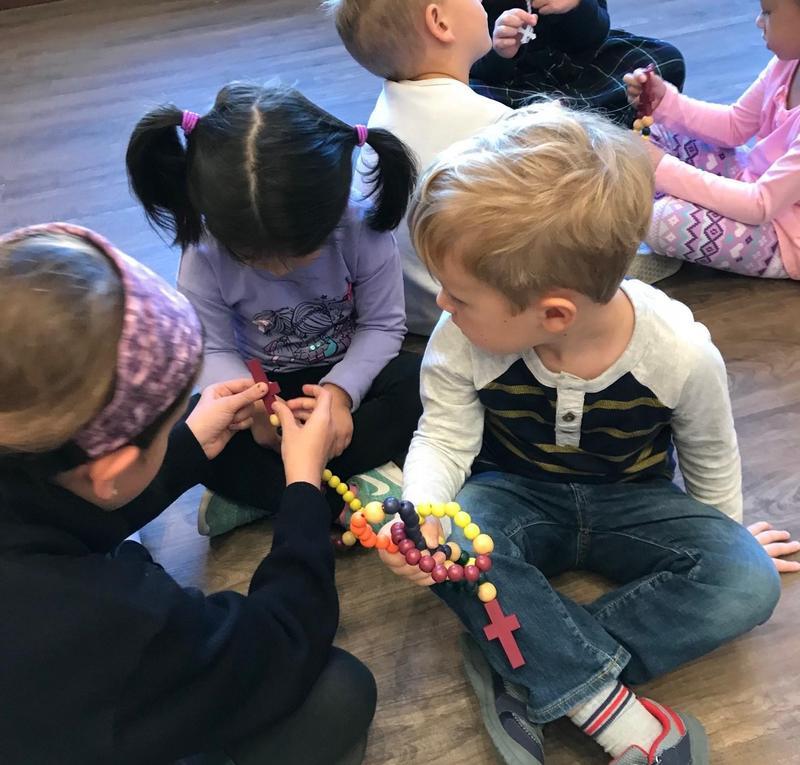 preschool learns the rosary