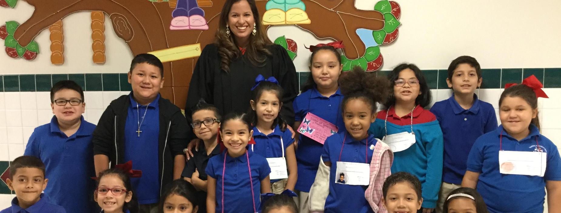 Judge Renee Rodriguez-Betancourt and Travis Students