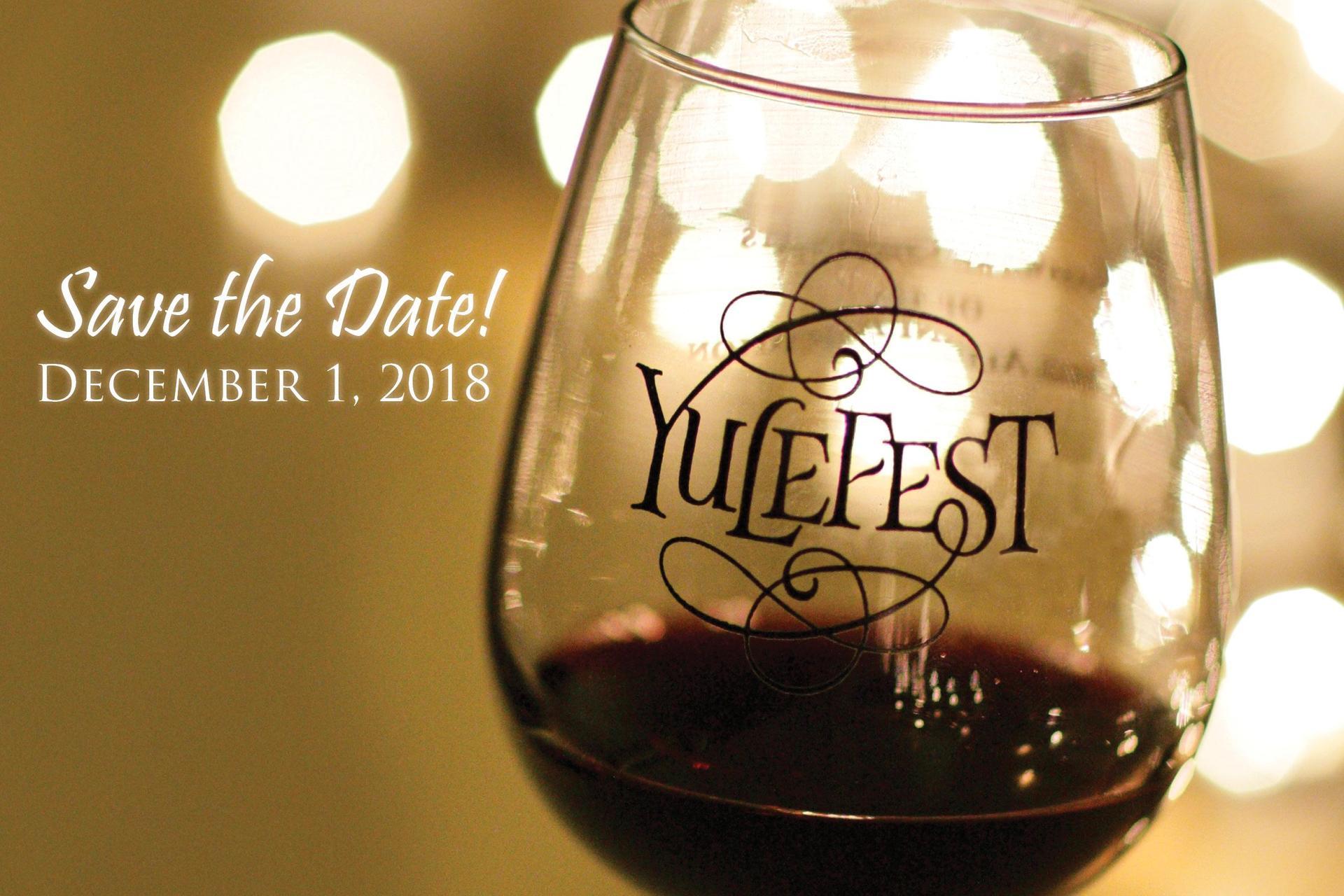 wine glass with Yulefest logo