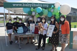 L.A. County Supervisor Hilda Solis presents Shirpser School Principal Veronica Ortiz with a commendation during a special donation event held at the school on Sept. 21. Pictured from left to right are Baby2Baby Co-presidents Kelly Sawyer Patricof and Norah Weinstein (wearing face shields), Solis, Ortiz, and El Monte City Superintendent Dr. Maribel Garcia.