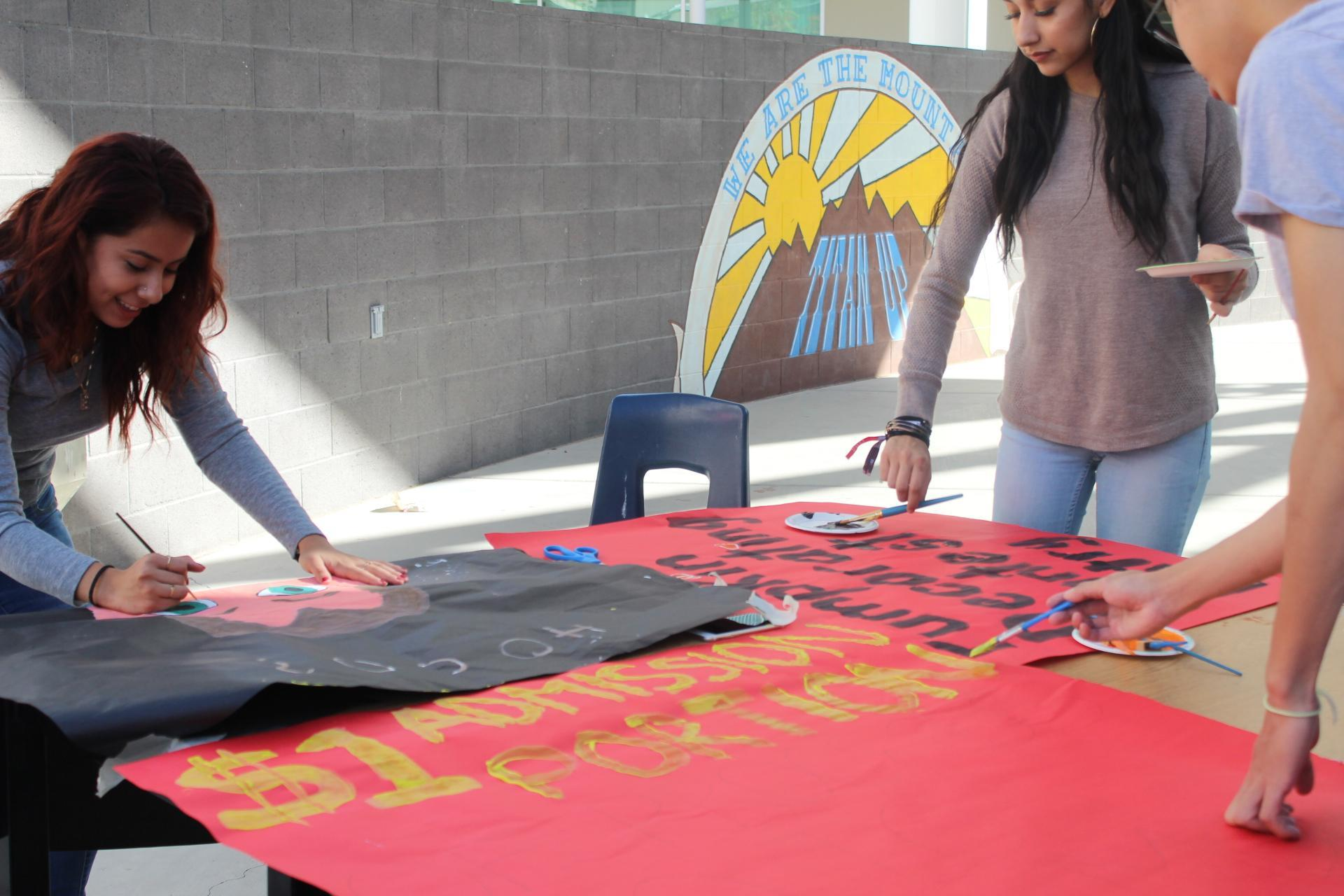 Students working on promoting the Halloween carnival