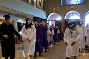 OLSH graduates prepare to process into the church