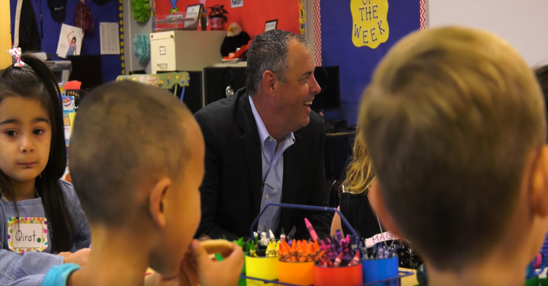 Dr. Plutko in a classroom with students.